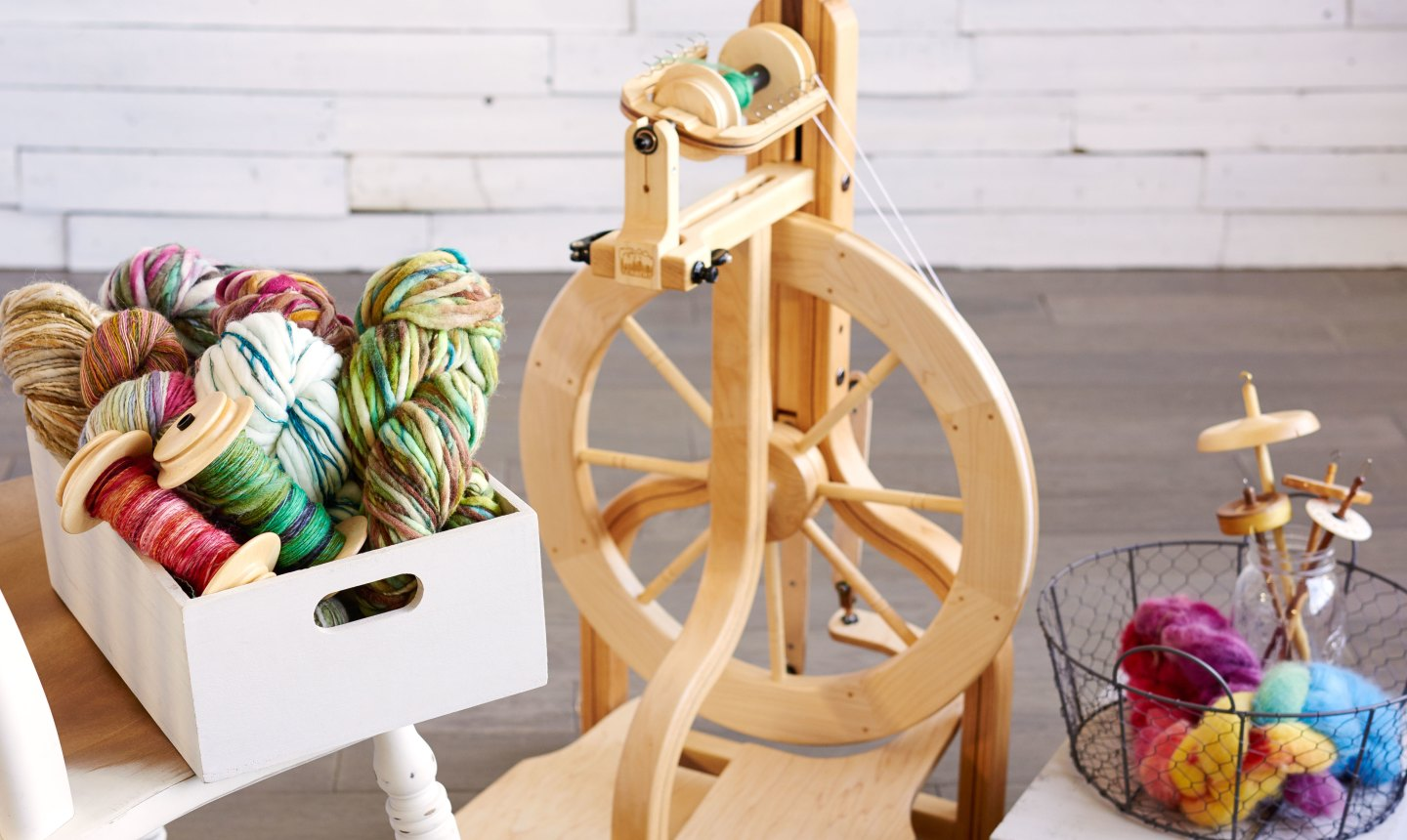 small spinning wheel with yarn