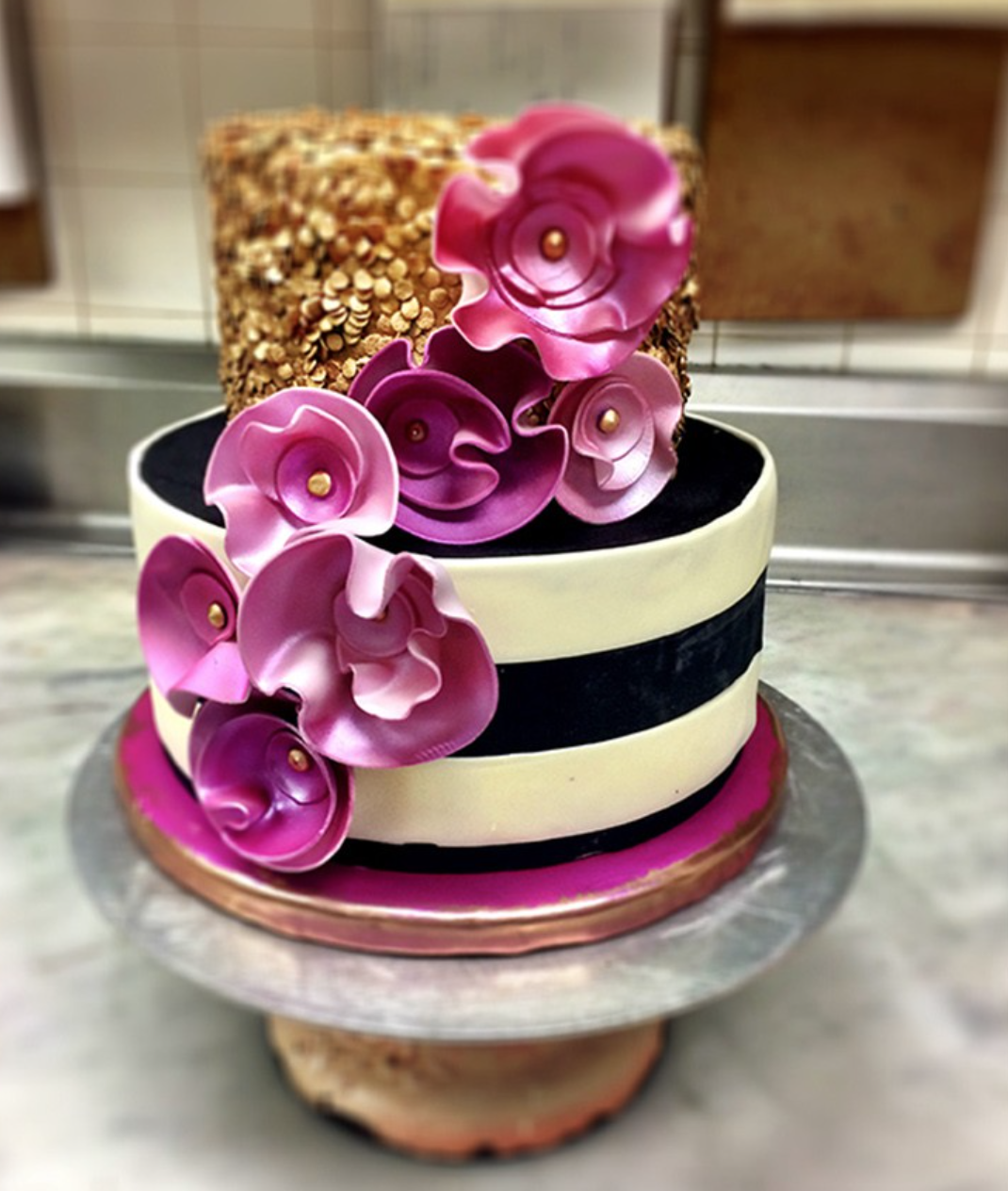 striped cakes with pink sugar flowers