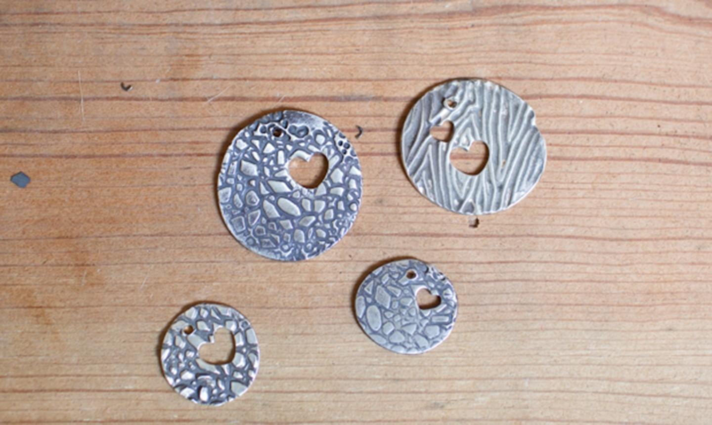 textured clay pendants