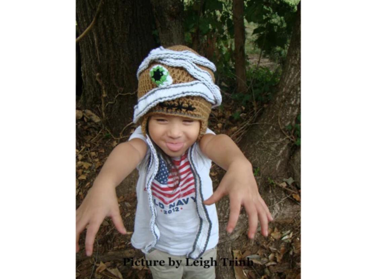 boy wearing crochet mummy hat
