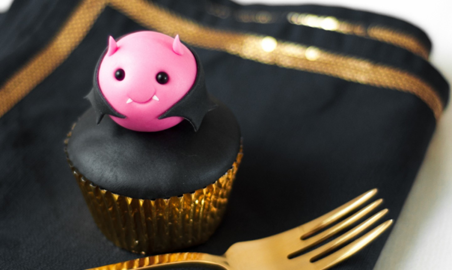 Cupcake with bat topper