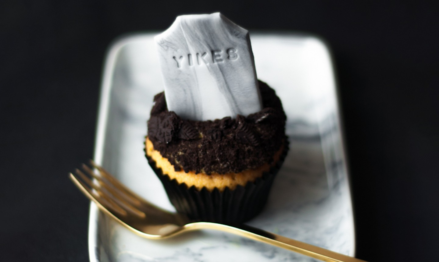Cupcake with headstone topper