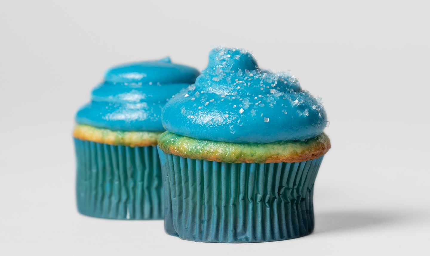 Cupcake with glowing blue frosting