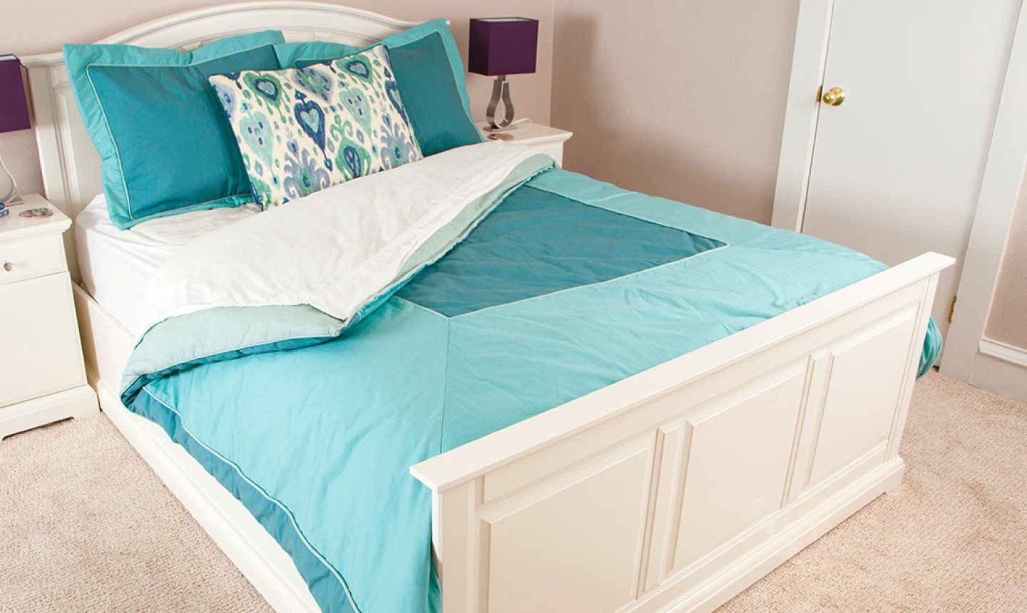 bed with teal bedding