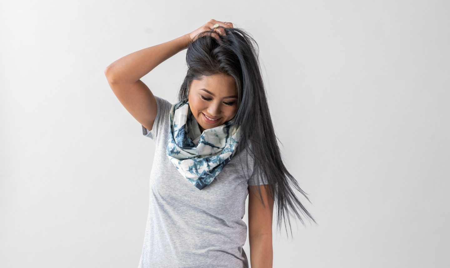 woman wearing infinity scarf