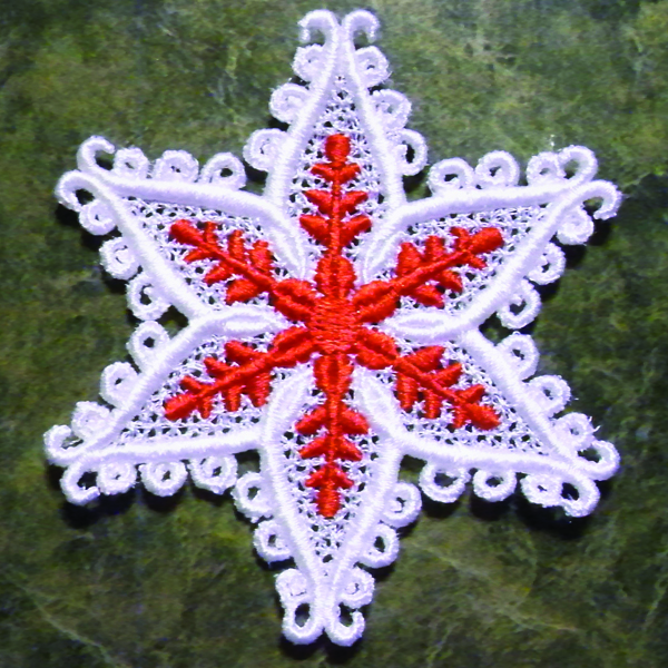 machine embroidered lace ornament