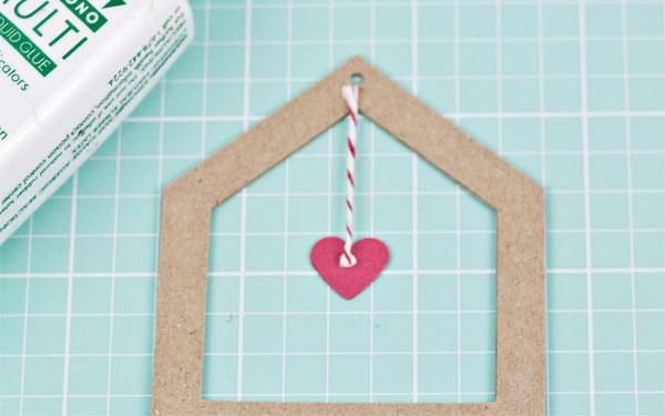 die cut ornament adding string