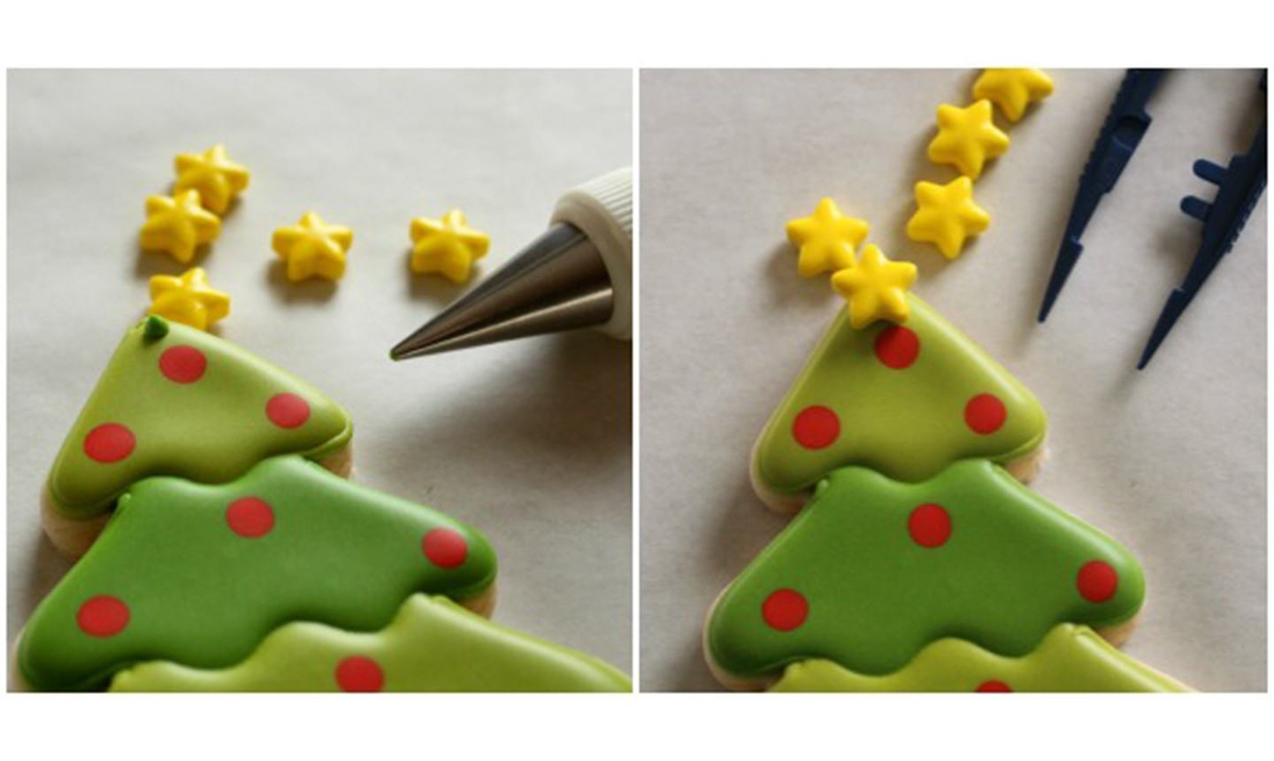 adding star sprinkle to christmas tree cookies