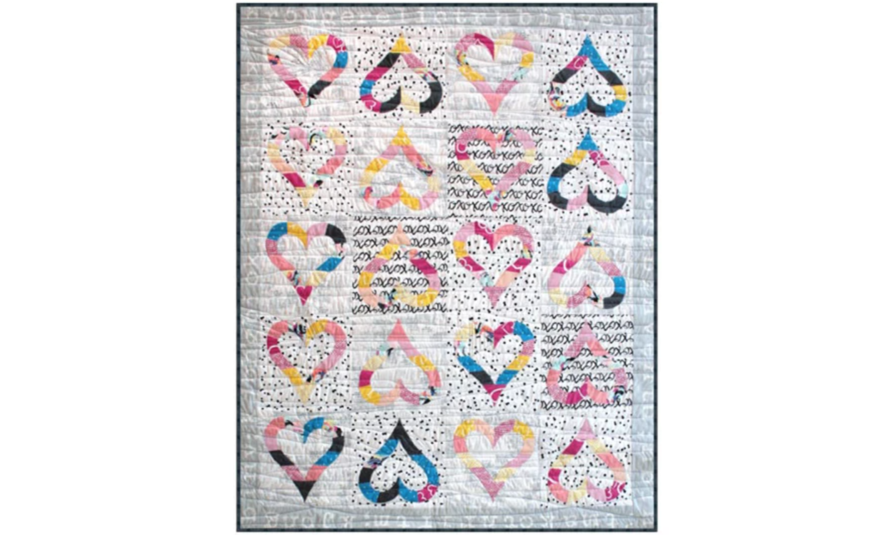 gray quilt with heart outlines