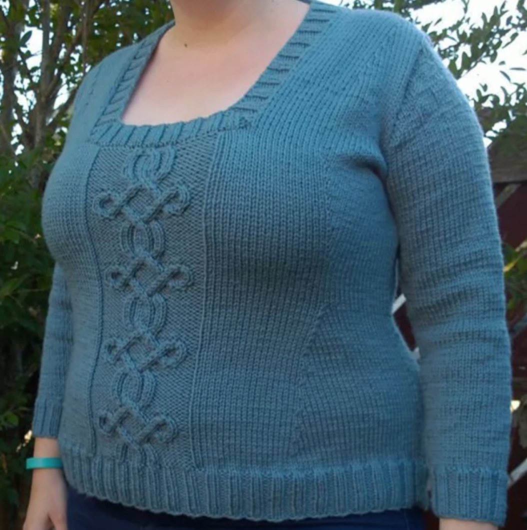 woman wearing blue Taliesin knit sweater
