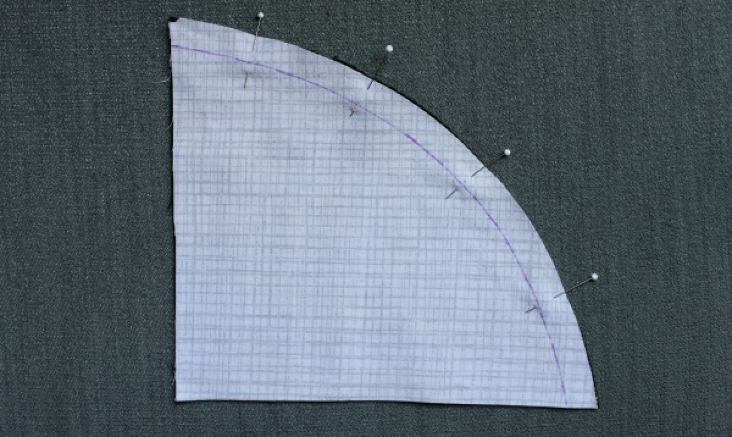 curved pattern piece on fabric