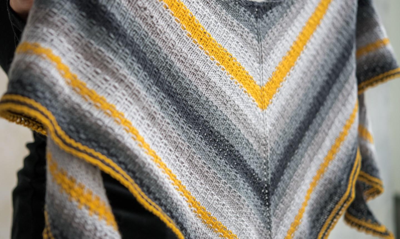 gray and gold knit shawl