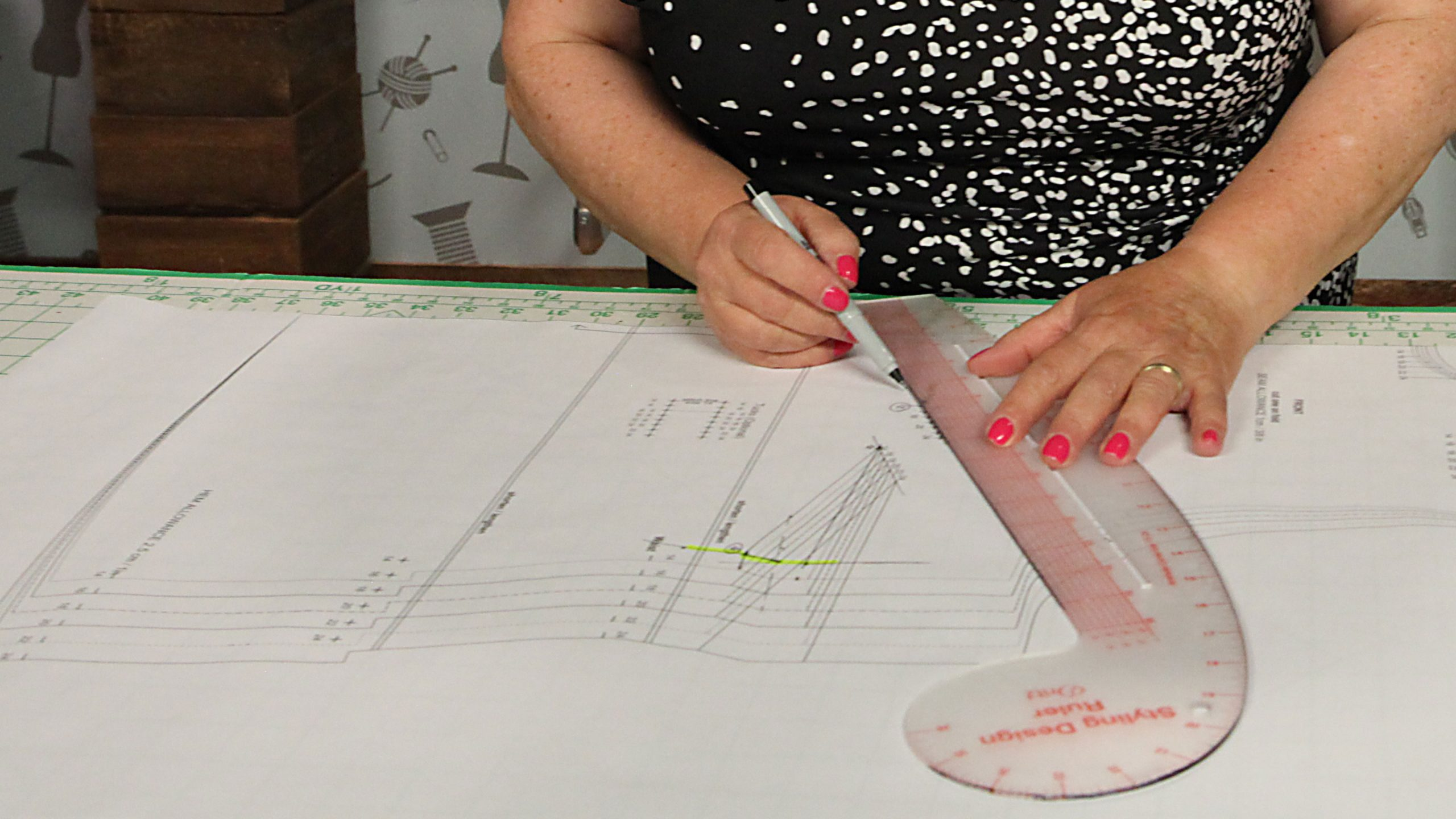 Women using curved ruler