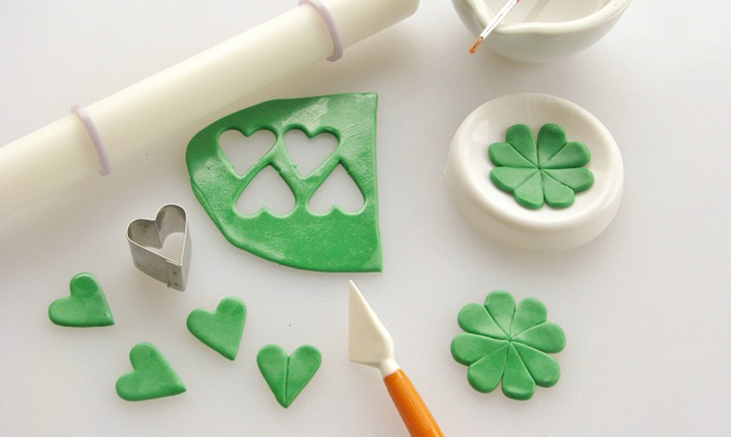 cutting out fondant clover
