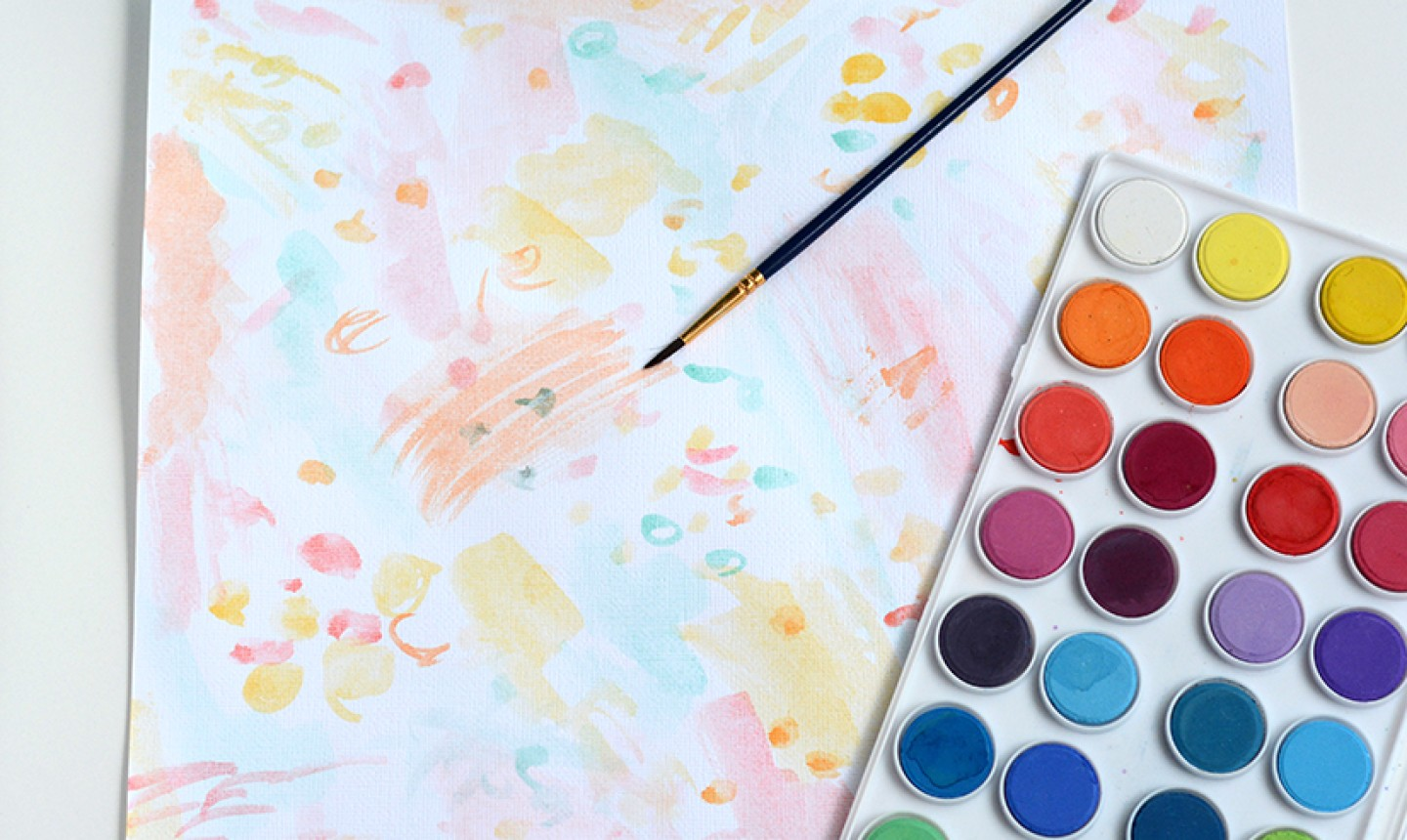 painting paper with watercolor