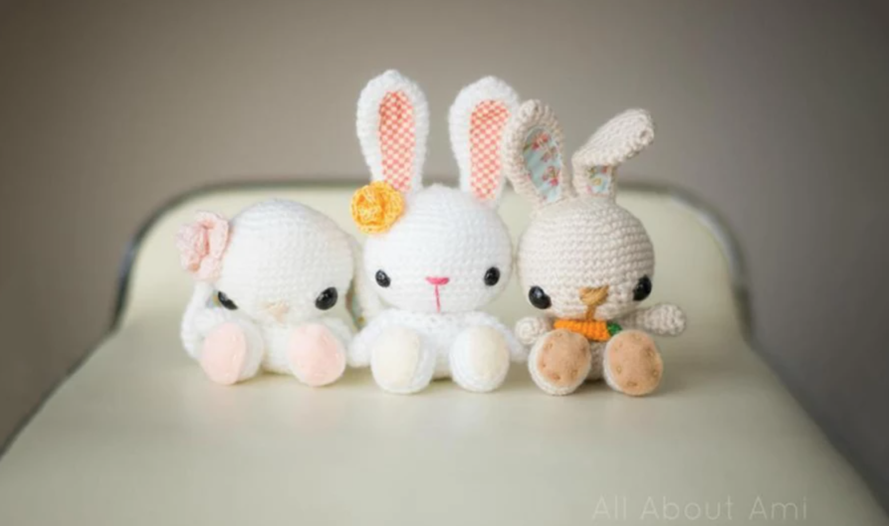 three amigurumi bunnies