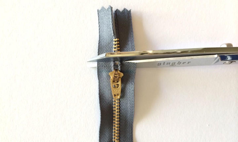cutting black zipper