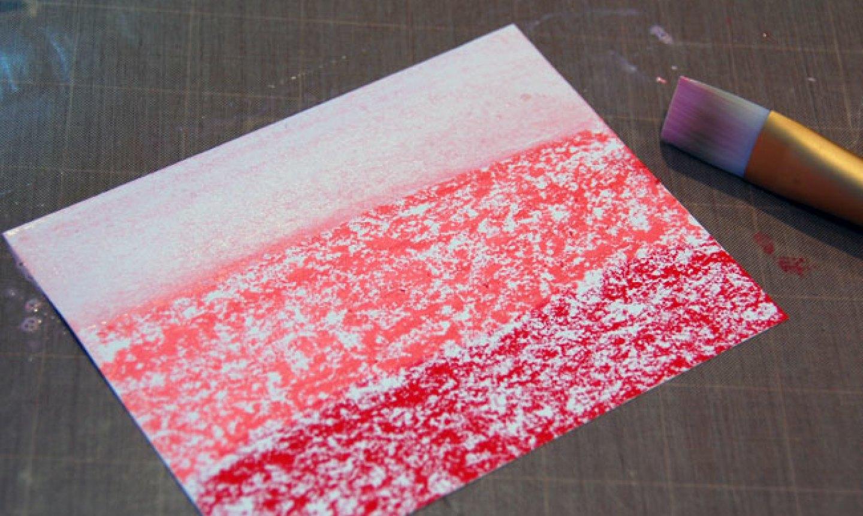 brushing gelatos on a card