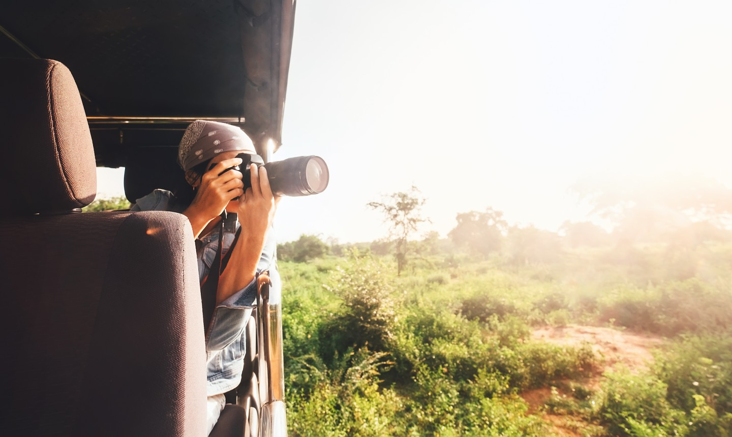 woman taking photo from vehicle