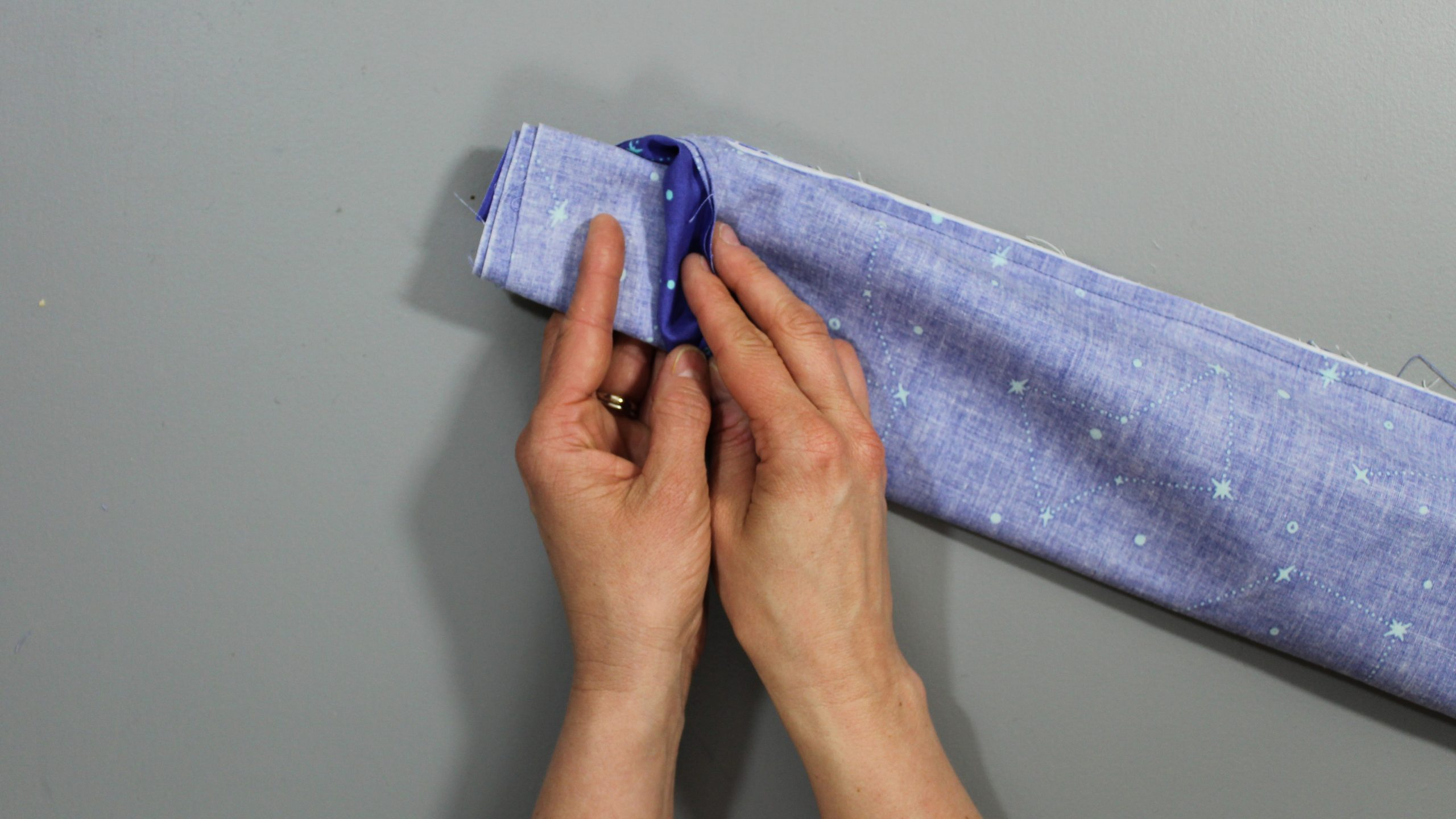 Unrolling fabric