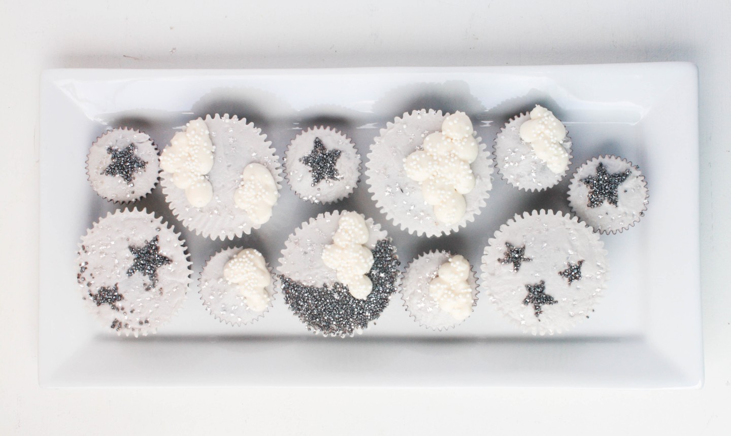 sparkly moon and stars cupcakes on a platter