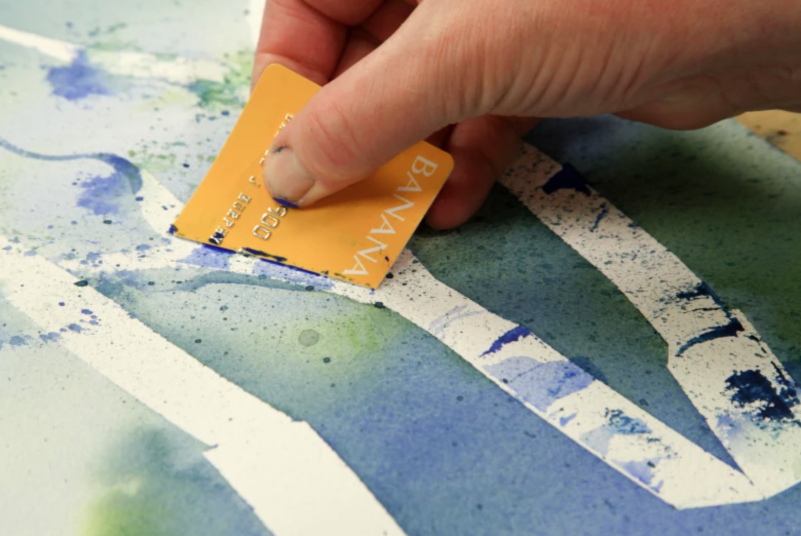 scraping watercolor with credit card