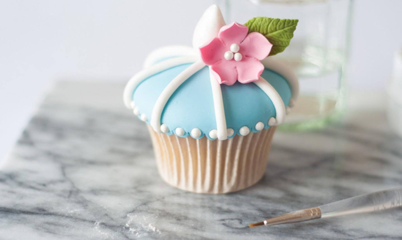 fondant flower on blue cupcake