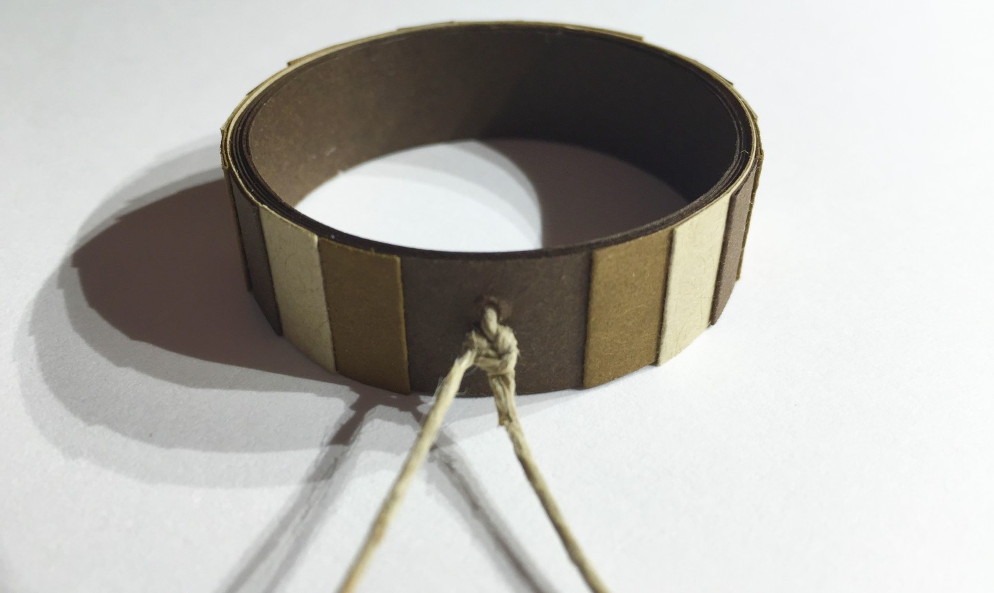 Twine attached to paper ring