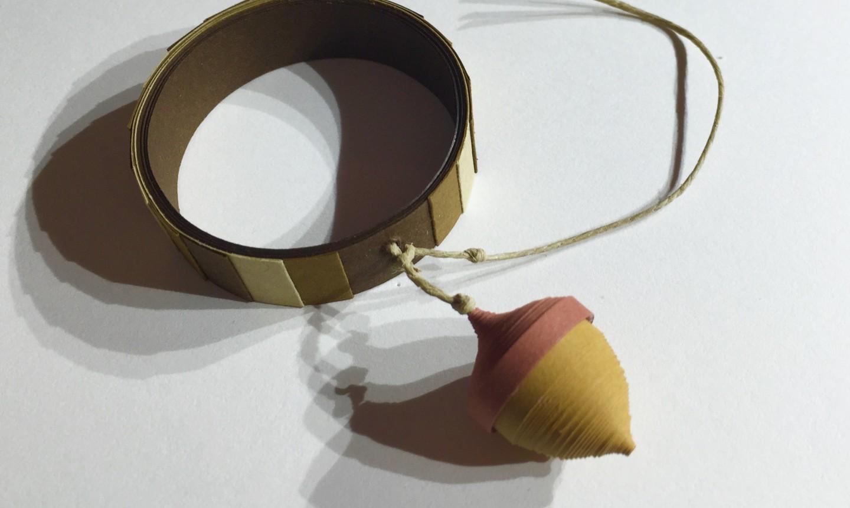 Quilled acorn tied around ring