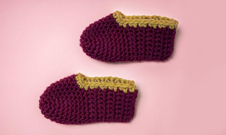 crochet baby booties flat lay