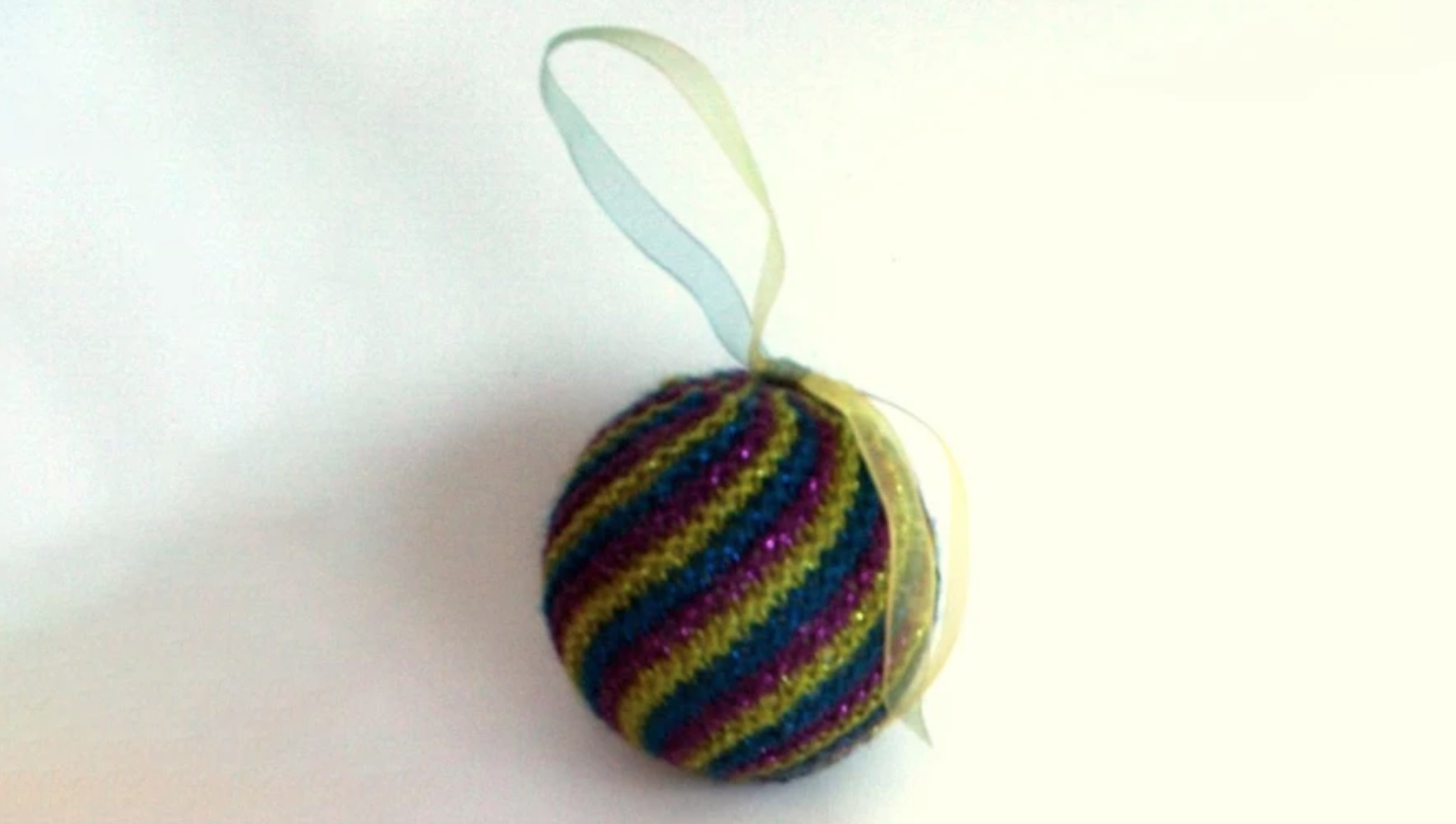knit swirled striped ornament