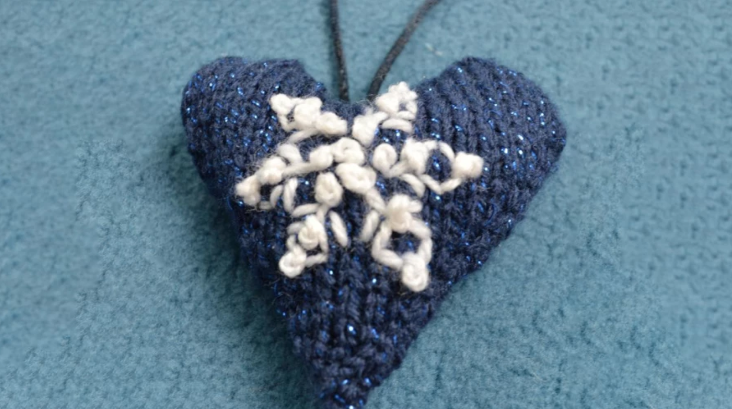 blue knit heart with embroidered snowflake