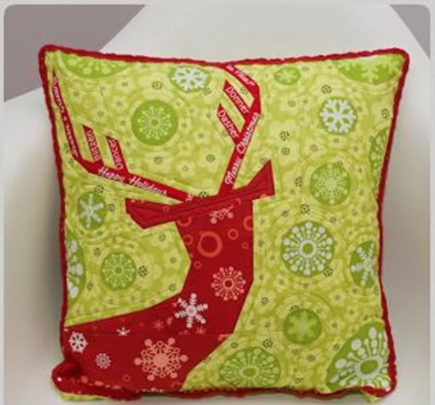 green and red quilted deer pillow