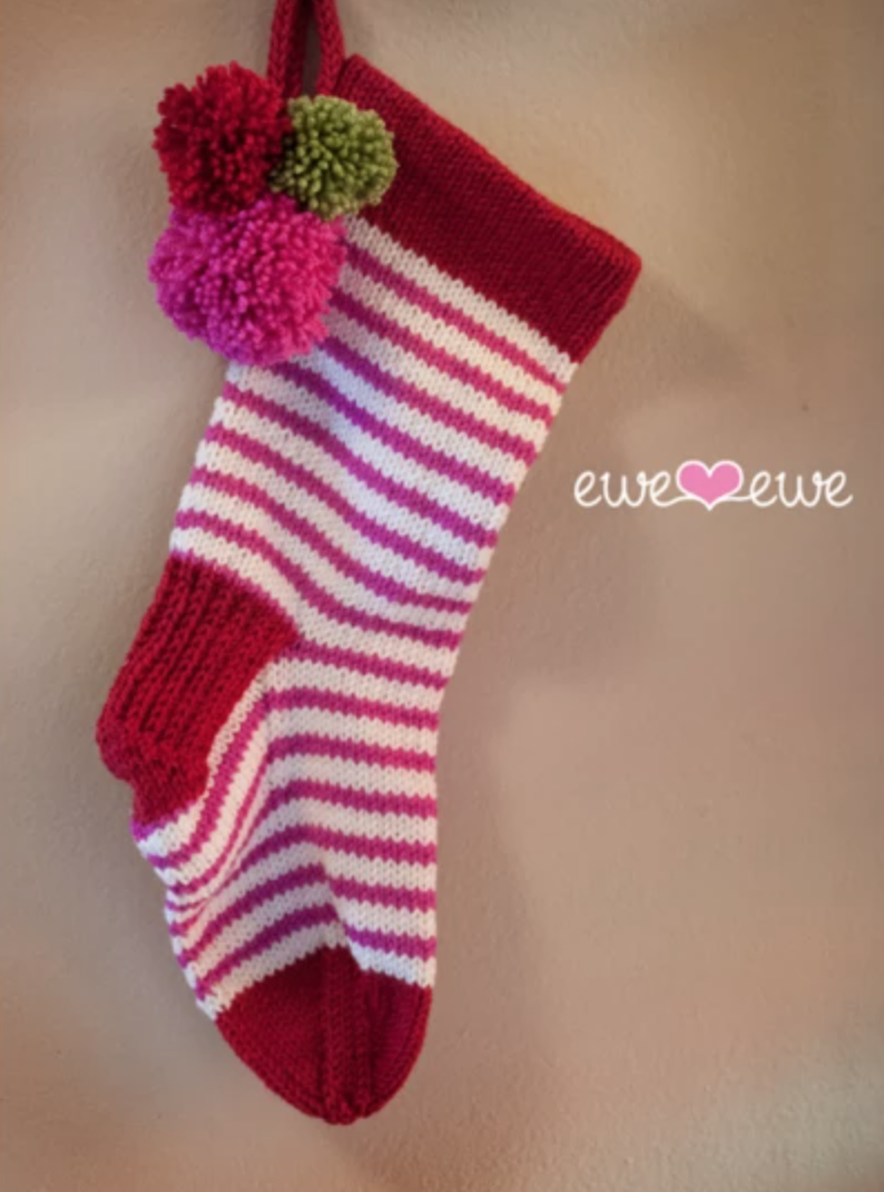striped stocking with pom poms