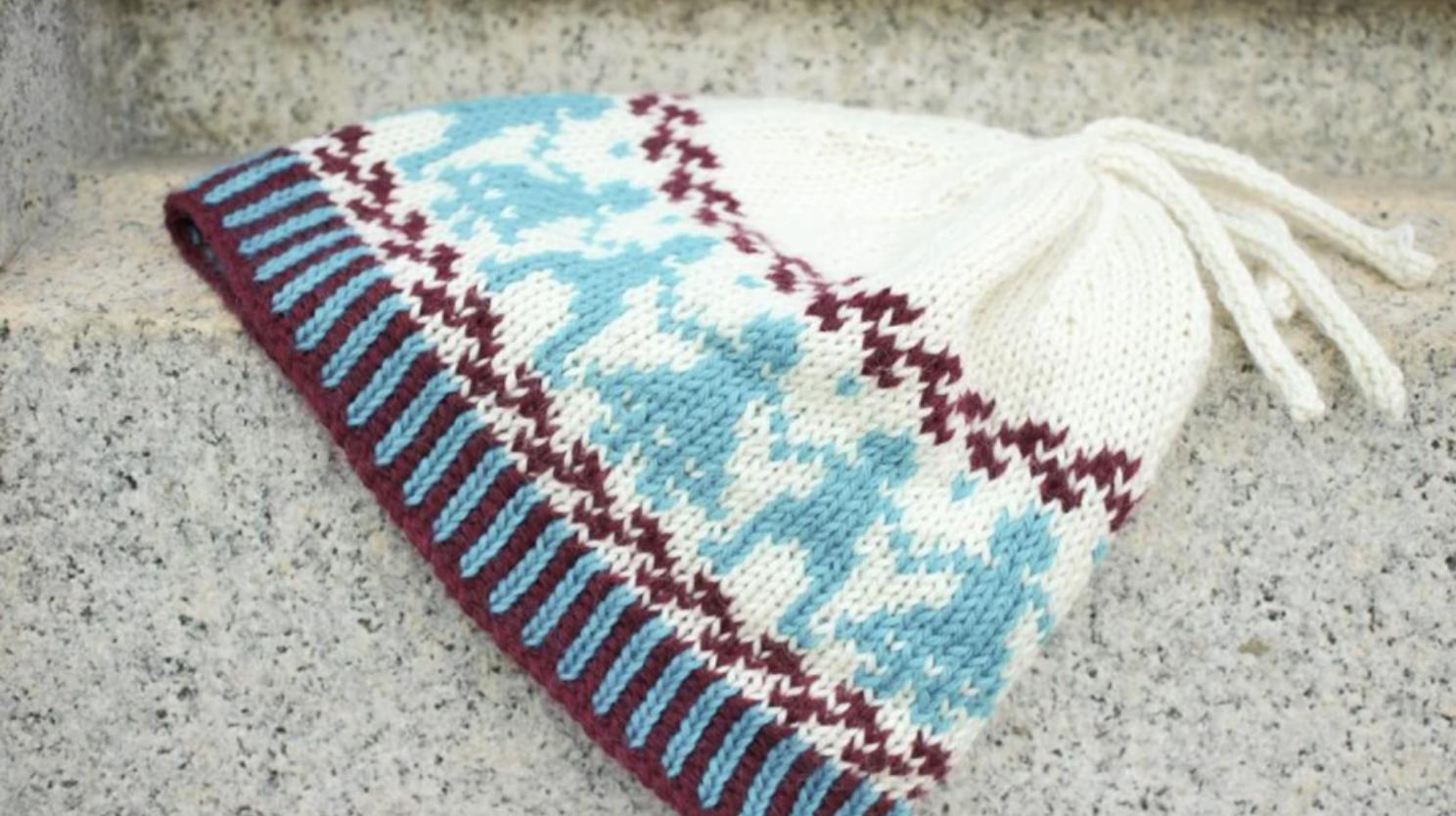 fair isle hat with boy and girl motifs