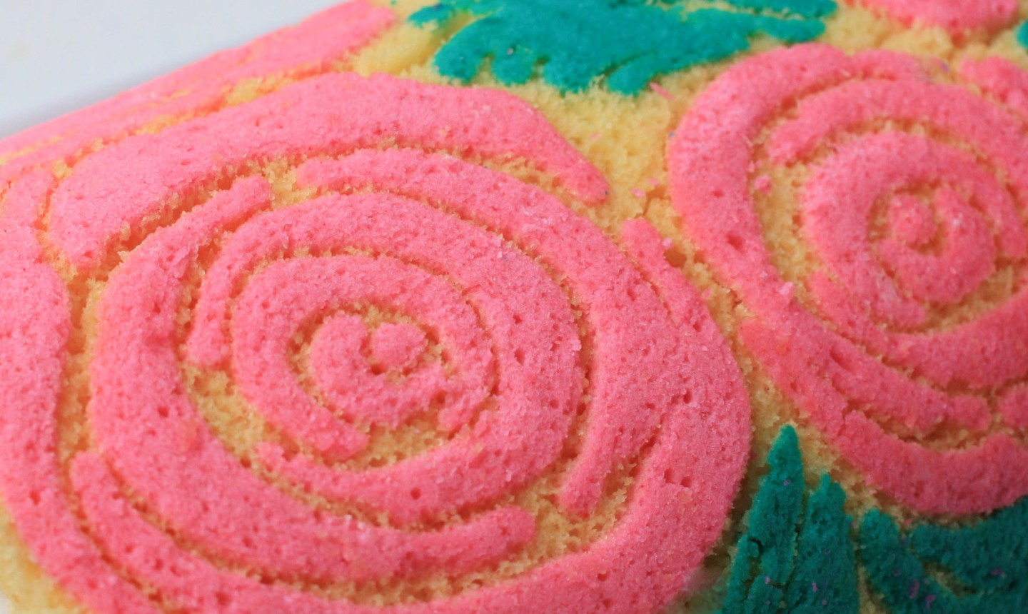 rose detail on roll cake