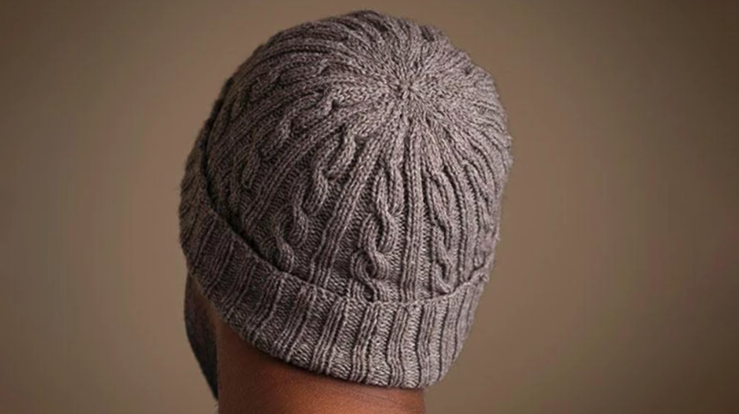 man wearing knit cabled hat