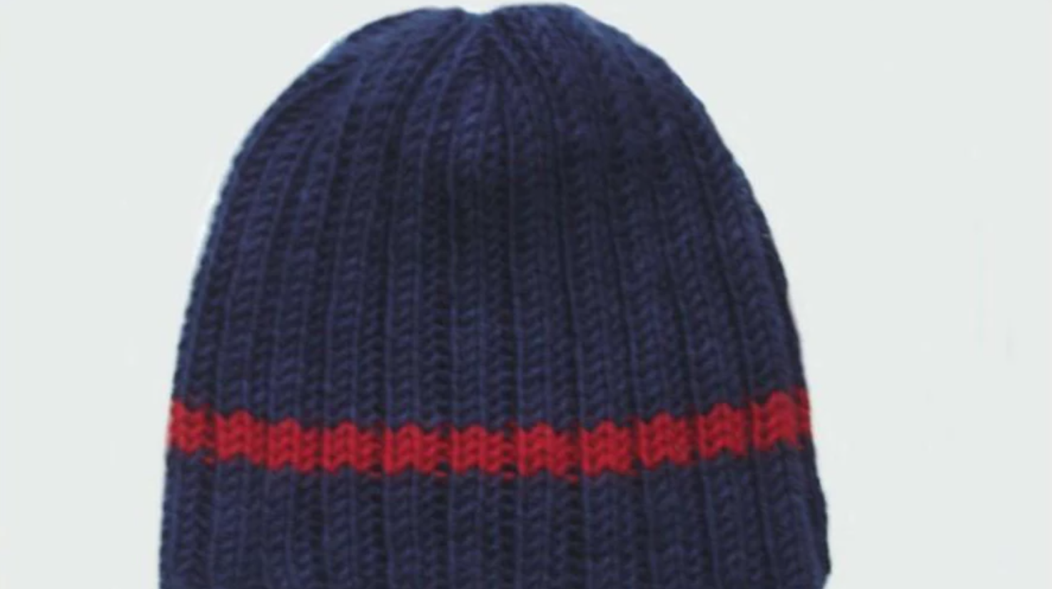 navy knit hat with red stripe