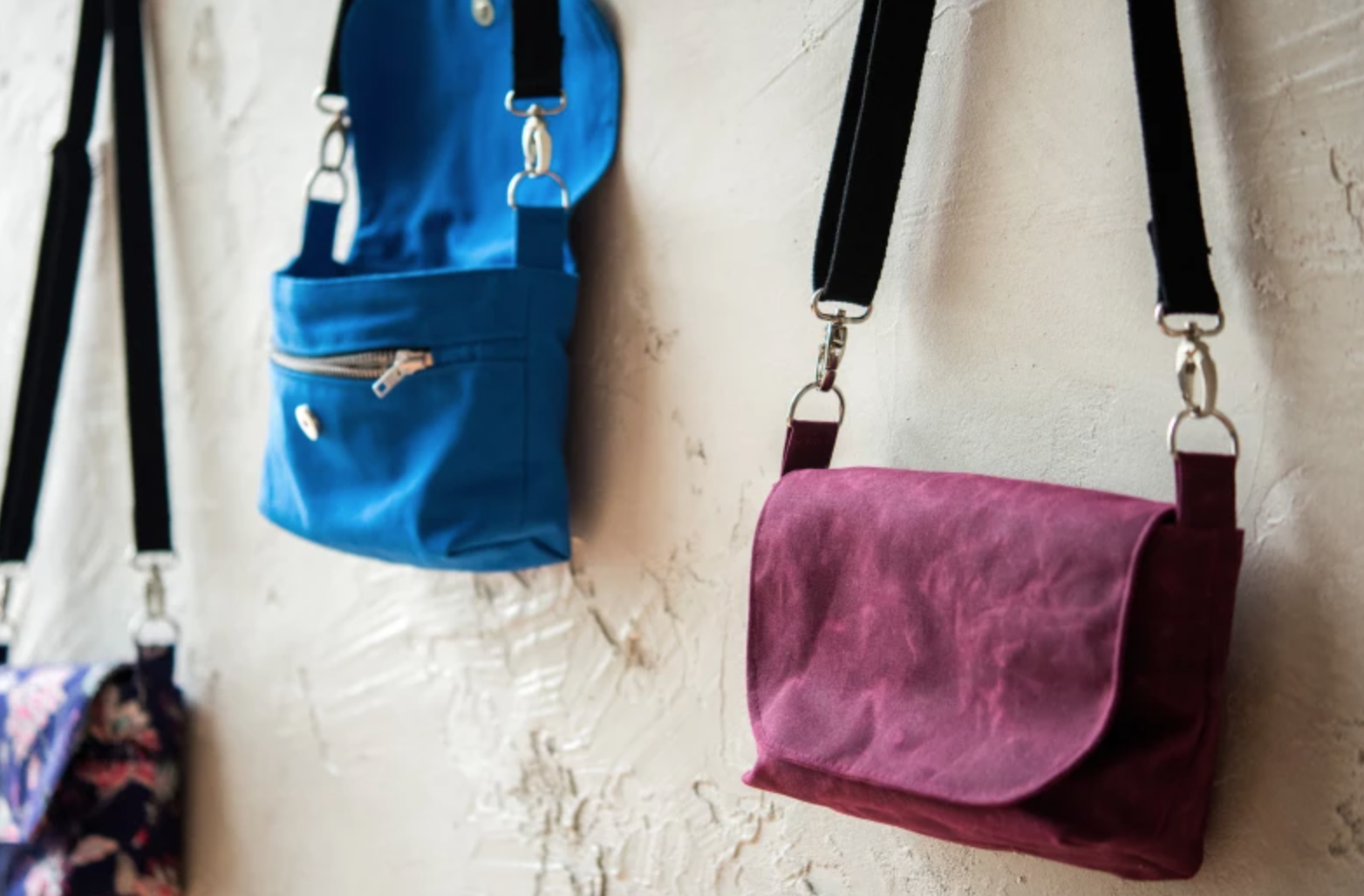 cross-body bags hanging on wall