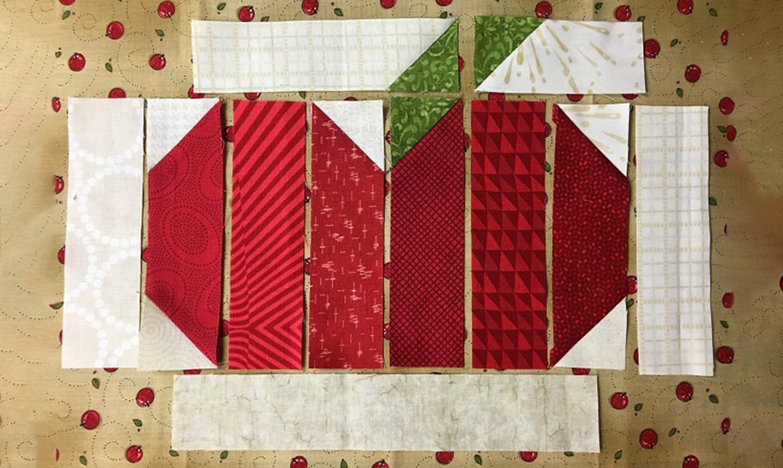 sewn strips of apple mug rug
