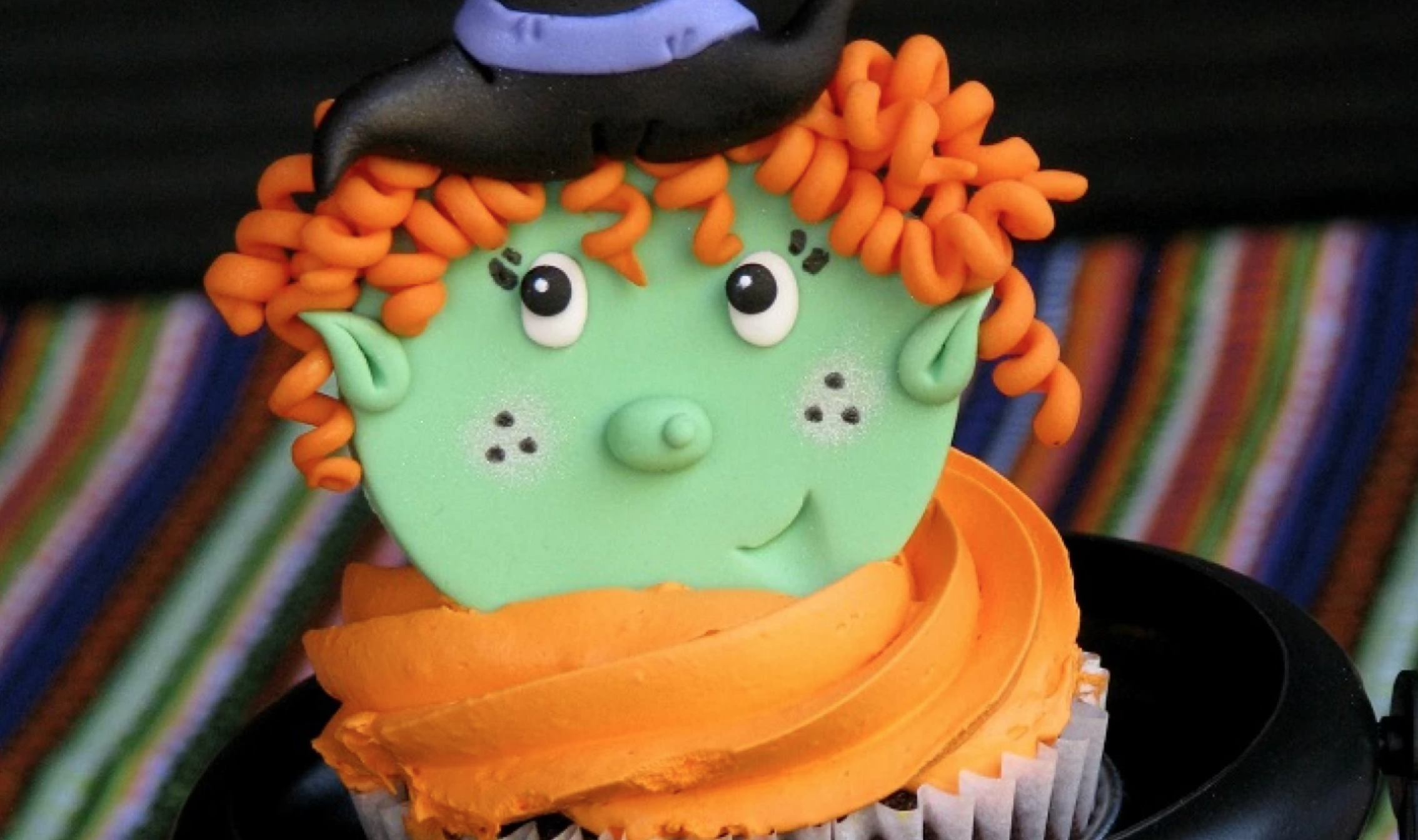 witch fondant topper on a cupcake