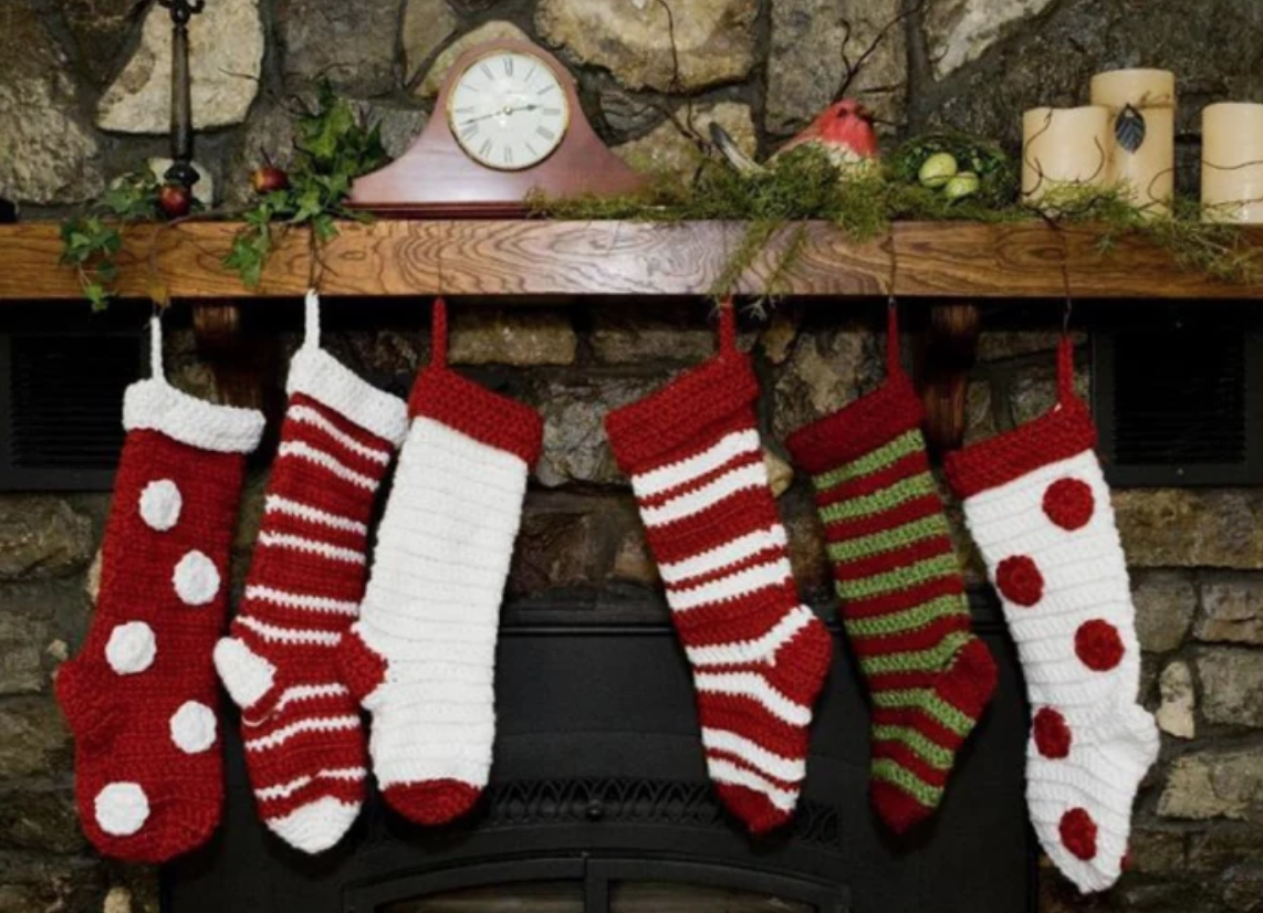 red and white hung christmas stockings