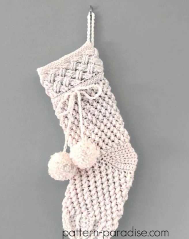 white crocheted stocking with pom poms