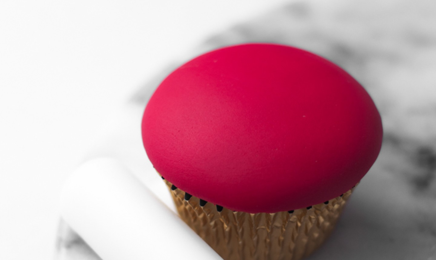 cupcake with red fondant top