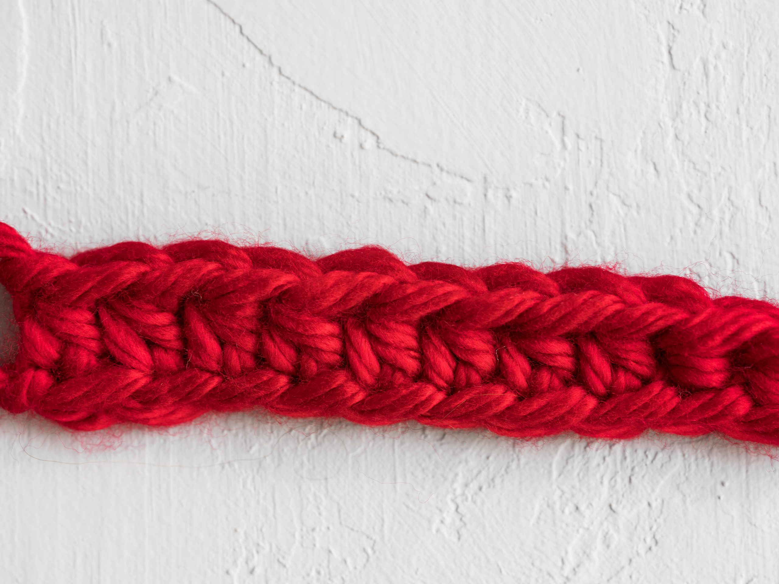 Red stitched line