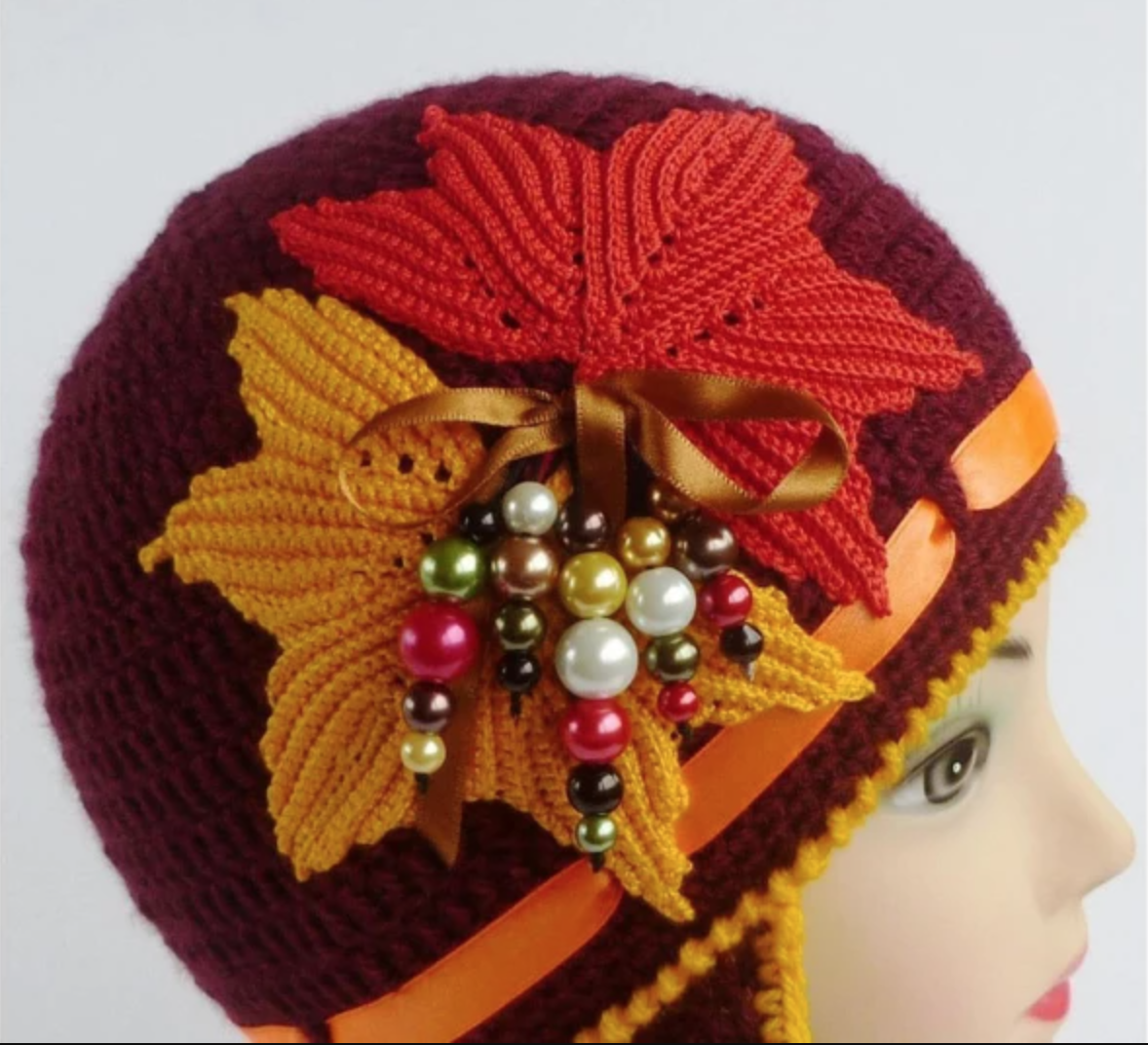 mannequin wearing crochet autumn hat