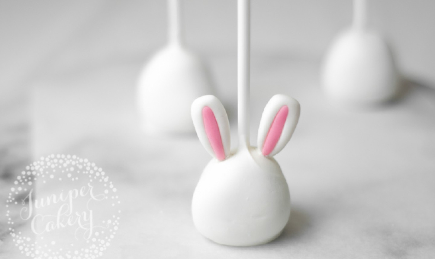 white cake pop with bunny ears