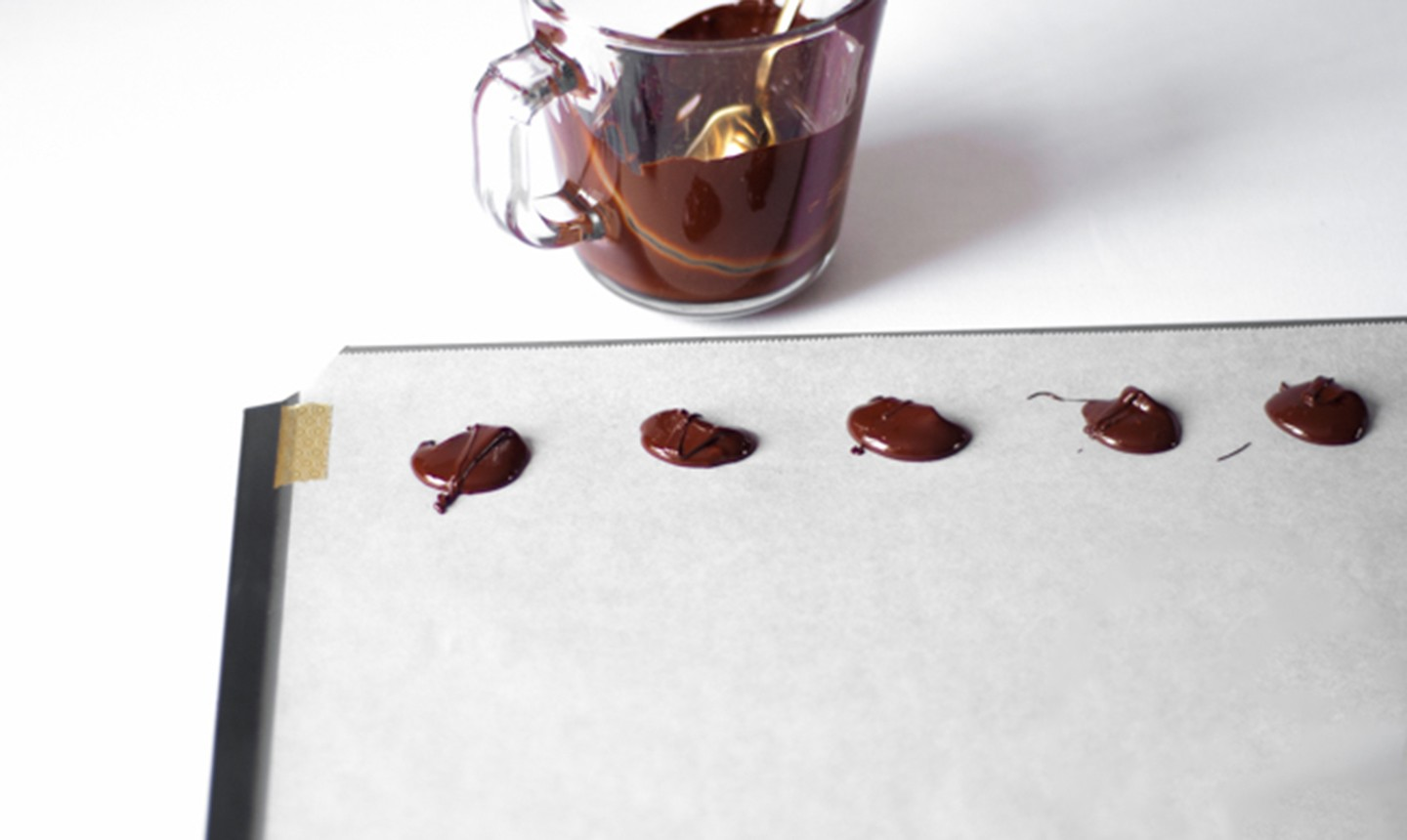 pouring candy melts onto wax paper