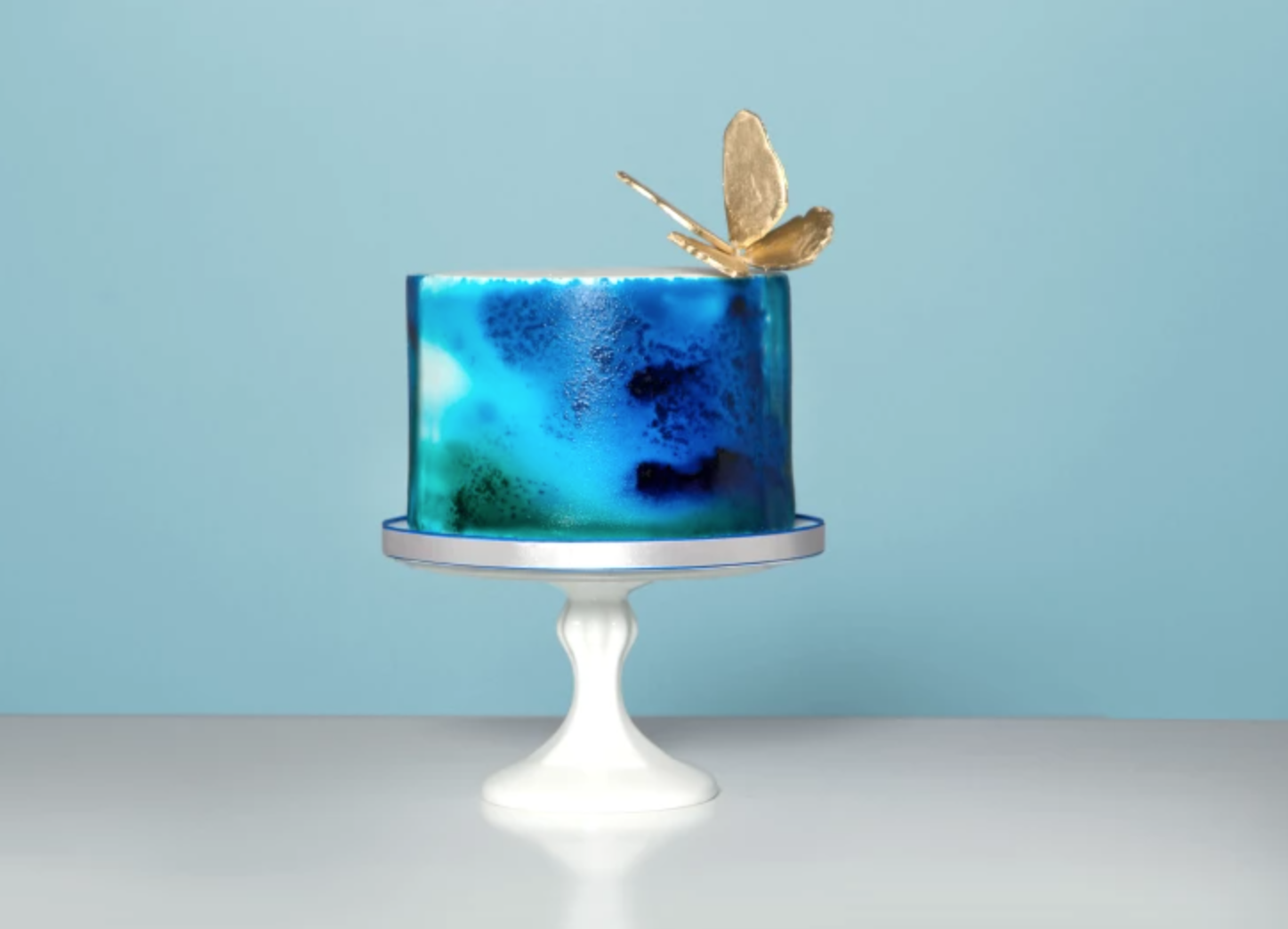 blue watercolor airbrushed cake