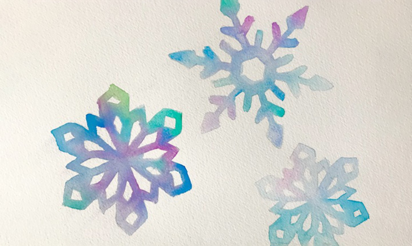 three painted watercolor snowflakes